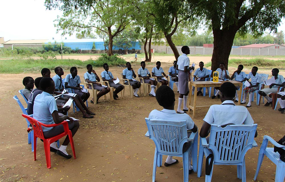Creating an enabling social-cultural environment for supporting girls' education.