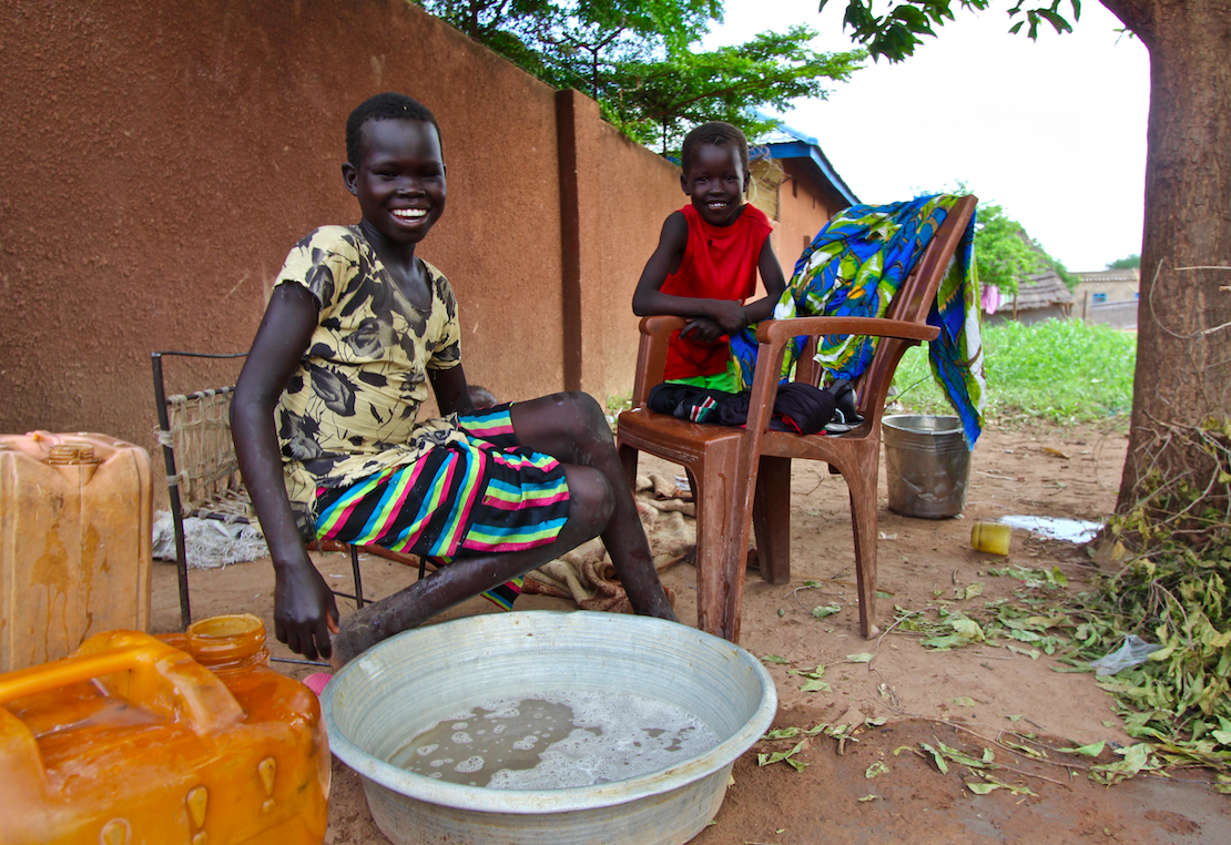 Girls in Kuajok attend to housework instead of going to school to learn.