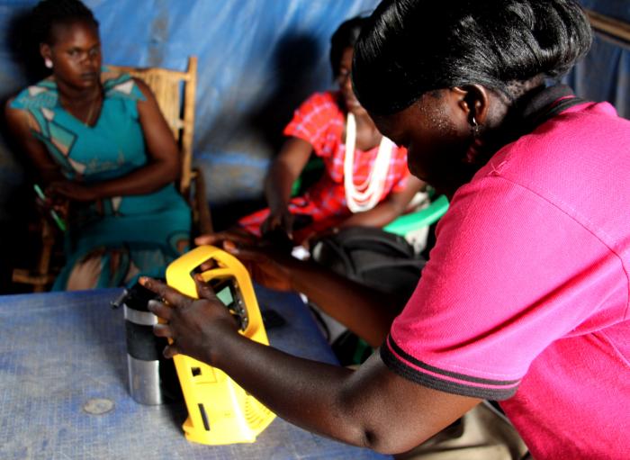 Women in South Sudan listen to radio